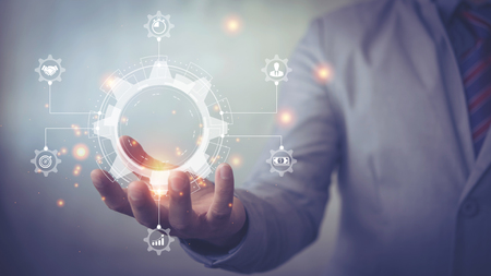 Business process management and workflow automation diagram with gears and icons with connection line network in background. Manager touching interface Stock Photo