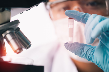 scientist with equipment and science experiments ,laboratory glassware containing chemical liquid for design or decorate science or other your content and selective focus Stockfoto