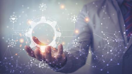 Bedrijfsprocesbeheer en workflowautomatiseringsdiagram met versnellingen en pictogrammen met verbindingslijnnetwerk op de achtergrond. Manager aanraken interface Stockfoto