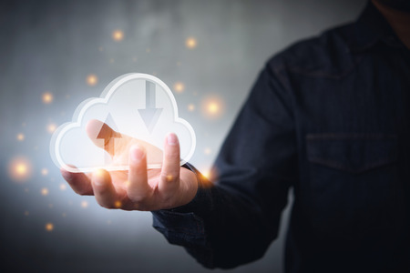 man holding icon cloud computing network and data information in hand.Cloud computing and technology concept.
