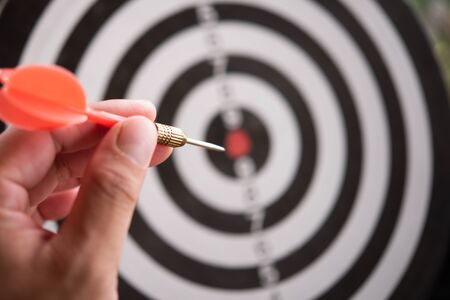Targeting concept.Bullseye is a target of business. Dart is an opportunity and Dartboard is the target and goal. So both of that represent a challenge in business marketing as concept. Stockfoto