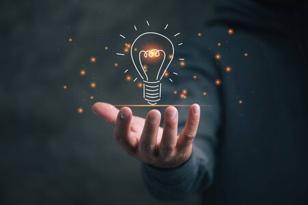 man holding icon light bulb,idea concept,,Presenting new ideas.