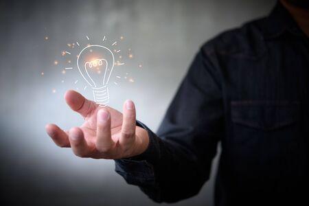 man holding icon light bulb,idea concept,,Presenting new ideas.