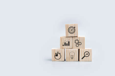 wood block with icon business strategy and Action plan, copy space.