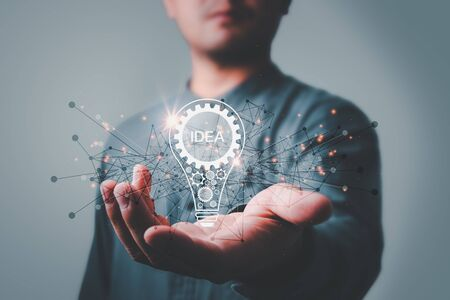 businessman holding light bulb. idea concept with innovation and inspiration Creativity and innovative are keys to success.Concept of new idea and innovation with light bulbs. Standard-Bild
