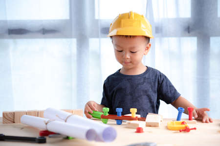Portrait asian Boy 2.6 years old Playing toys.To learn and enhance development, little architect.