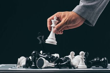 Businessman play with chess game. concept of business strategy and tactic.strategy, management or leadership concept