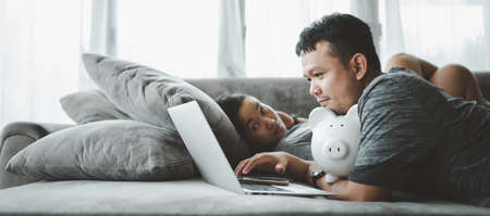 Beautiful young asian couple calculate expenses finance with laptop and planning together Looking for investment. lifestyle family and business concept.