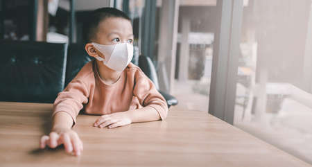 Portrait asian Boy 3 years old protective mask on face  coronavirus and epidemic virus symptoms.Coronavirus and Air pollution pm2.5 concept.Innocent child
