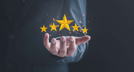 feedback rating and positive customer review experience, satisfaction survey. Customer Experiences Concept. Five Stars Rating floating on Hand.