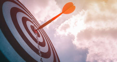 business marketing as concept. Black dart arrow hitting in the target center of dartboard Target hit in the center, goal action planing concept.
