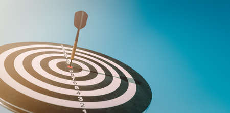 business marketing as concept. Black dart arrow hitting in the target center of dartboard Target hit in the center. 版權商用圖片