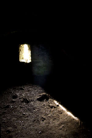 A ray of hope in dark dungeon pointed on ground
