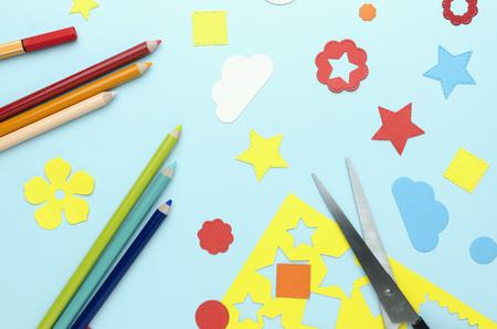 Pencils, scissors and bright paper decorations