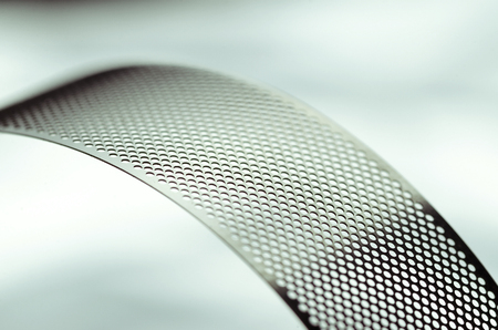 Metal perforated tape, curved abstract