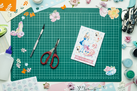 Homemade greeting card and tools on the cutting mat. Scrapbooking, top view Banque d'images - 104192290