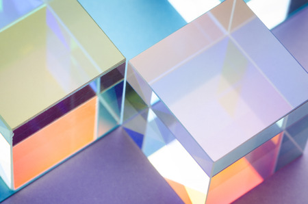 Multi-colored glowing glass cubes, abstract colorful background