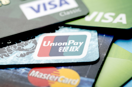 Beijing, China - April 6, 2019: Union Pay, Visa and MasterCard payment system cards close-up