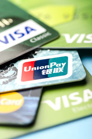 Beijing, China - April 6, 2019: UnionPay, Visa and MasterCard cards close-up, vertically 報道画像