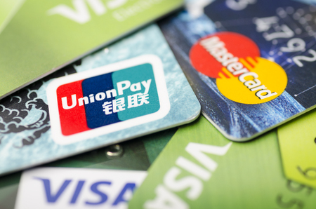 Beijing, China - April 6, 2019: Union Pay, Visa and MasterCard payment system cards close-up Banque d'images - 122809768