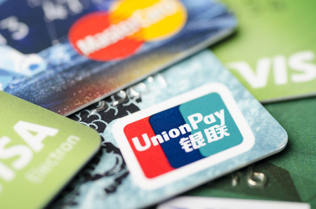 Beijing, China - April 6, 2019: UnionPay, Visa and MasterCard cards close-up, soft focus 報道画像