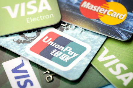 Beijing, China - April 6, 2019: UnionPay, Visa and MasterCard cards close-up