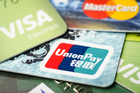 Beijing, China - April 6, 2019: Cards of Union Pay, Visa and MasterCard payment systems