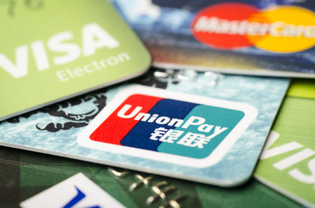 Beijing, China - April 6, 2019: Union Pay, Visa and MasterCard credit cards close-up