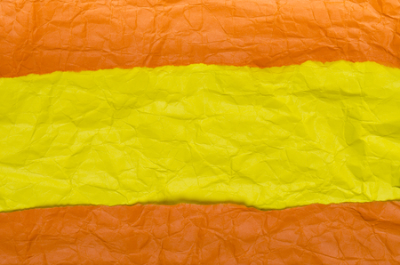 Background of crumpled paper yellow orange horizontal