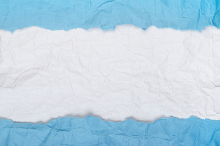 Background of crumpled paper white blue horizontal