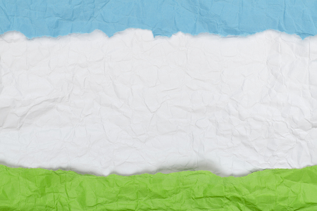 Background of crumpled paper blue white green horizontal