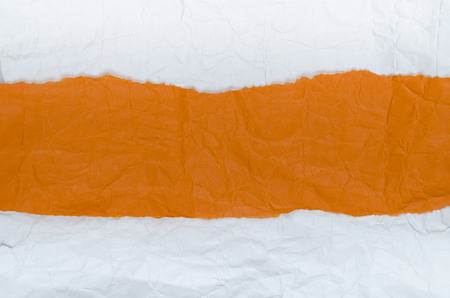 Background of crumpled paper white orange horizontal