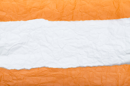 Background of strips of crumpled paper orange white