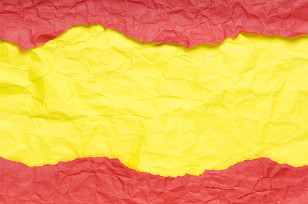 Background of strips of crumpled paper red yellow