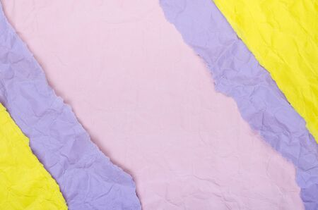 Background of strips of crumpled paper yellow purple and pink