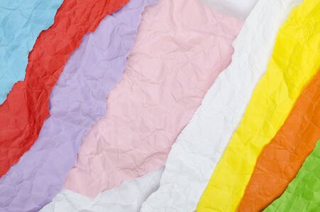 Background of strips of crumpled paper in different colors Banque d'images