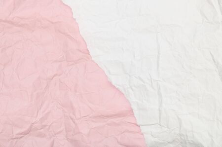 Background of a piece of crumpled paper pink and white Banque d'images