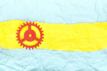 Background crumpled paper with yellow stripe and red paper gear Banque d'images