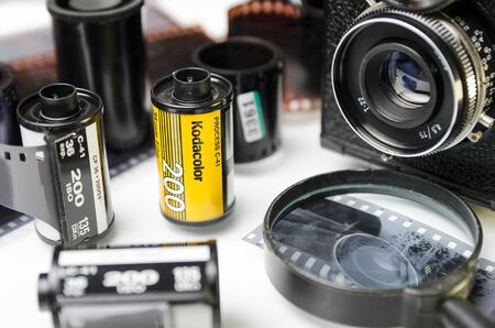 Moscow, Russia - may 21, 2019: Kodak film, film camera, and developed film close-up
