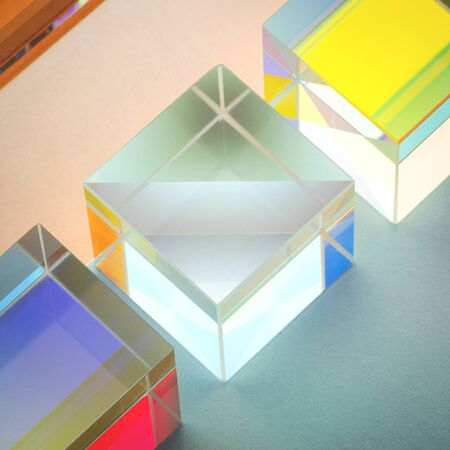 iridescent multicolored glass square prisms close-up, abstraction