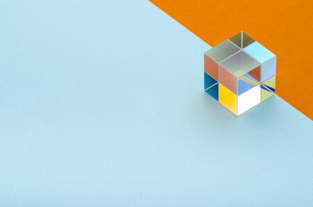glittering glass cube on orange and blue background, minimalism, abstraction Banque d'images