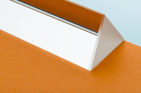 bright triangular prism on orange-blue background, minimalism, abstraction