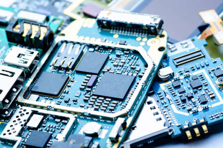 Electronic boards with chips, electronic components and precious metals close-up, soft focus Archivio Fotografico