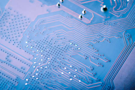 Abstract pattern of conductive paths on an electronic board close-up, soft focus, background