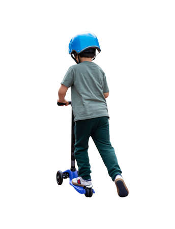 Isolated rear view Little kid learning to ride a scooter, Back view Prortrait Child boy in safety helmet riding a roller on white background, Active leisure and outdoor sport for children.