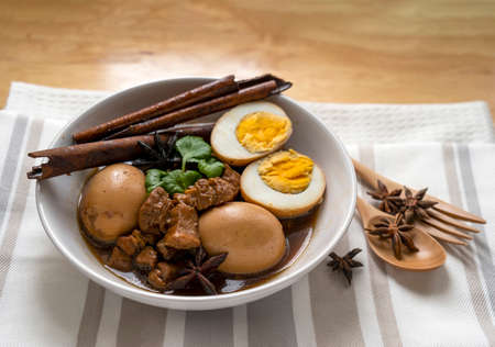 Homemade food, Stewed pork and Eggs with herb in sweet brown soup, Thai traditional food, Local or Street food favourite menu in Thailand. Thai name is Khai palo 版權商用圖片