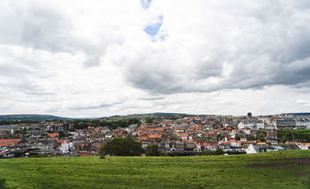 Whitby, North Yorkshire, England - July 21, 2020:,UK. Panorama view from top of Whitby Abbey looking to old town city,The harbour at Whitby on the North Yorkshire coast