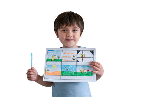Preschool boy showing his drawing on paper, Active 5-6 years kid with proud face holding his painting bee on field for his school homework,  Smiling little child holding picture of bee and flowers.