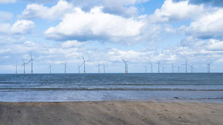 Seascape  Windmill farm in the ocean,  Row of floating wind turbines, Landscape offshore wind turbines in Middlebrough, United kingdom