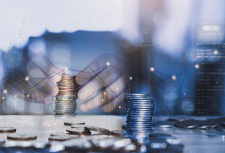 Double exposure of  trading graph and hand stack sterling coin with blurry building in london at night, The Image can us for Business and financial investment background concept 版權商用圖片